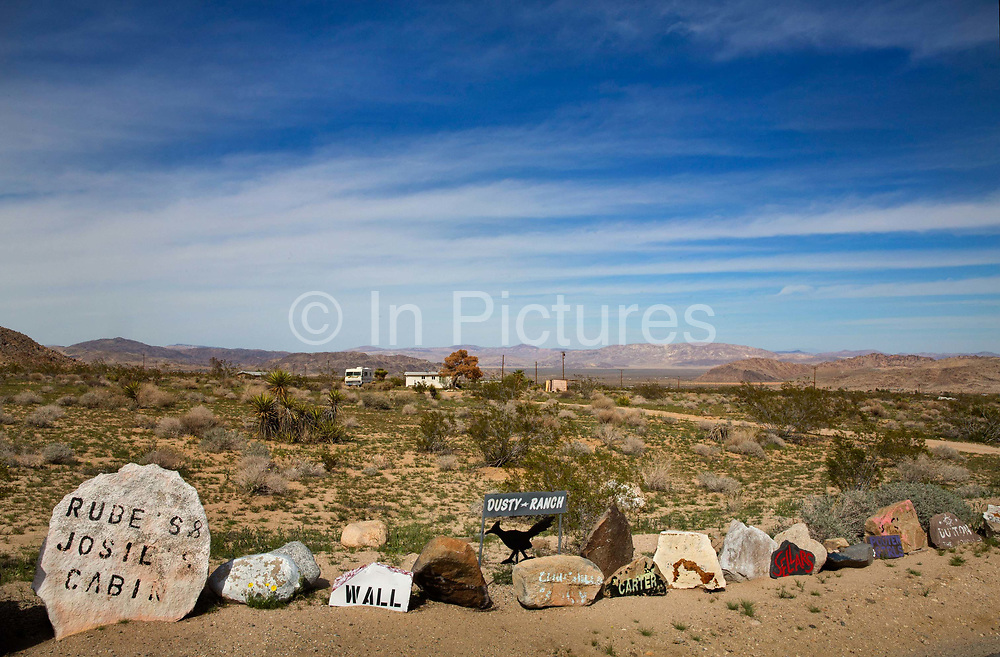 Rural Street signs, Californian Desert. The start of a long residential road into the Rodman Mountains Wilderness Area. House signs at the start ensure you are driving in the right direction.