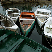 Old fishing dinghies at a dock used by commercial fishermen in Rockport, Massachusetts, on Cape Ann. The region has support fishing for over 300 years.