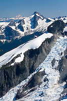 Icy Peak (7073 feet, 2156 meters) displaying the Spillway Glacier, seen from the summit of Ruth Mountain Mount Blum is in the distance, North Cascades Washington