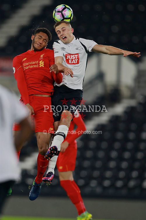 DERBY, ENGLAND - Monday, November 28, 2016: Liverpool's Joe Gomez in action against Derby County's Charles Vernam during the FA Premier League 2 Under-23 match at Pride Park. (Pic by David Rawcliffe/Propaganda)