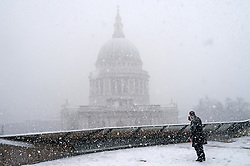 © Licensed to London News Pictures. 28/02/2018. London, UK.  A man take a selfie with St Paul's Cathedral in the background as heavy snowfall hits central London at lunchtime. The cold spell named The Beast From The East is due to last a few days. Photo credit: Ray Tang/LNP