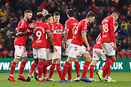 Middlesbrough forward Britt Assombalonga (9) celebrates with team mates after scoring his team's first goal during The FA Cup 3rd round match between Middlesbrough and Peterborough United at the Riverside Stadium, Middlesbrough, England on 5 January 2019.