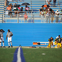 Sidelines of a high school football game.