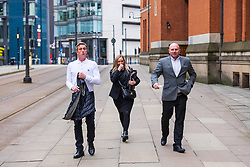 © Licensed to London News Pictures . 23/03/2021. Manchester , UK . Former Manchester United and England footballer RONNIE WALLWORK (right) and DAVID GARNER (left) leave Minshull Street Crown Court . The pair were handed non-custodial sentences after previously pleading guilty to inflicting grievous bodily harm upon a man during an incident at a bar on 22nd December 2019 . Photo credit : Joel Goodman/LNP