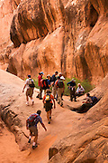 Park Ranger lead hike in the Fiery Furnace, Arches National Park, near Moab, Utah.