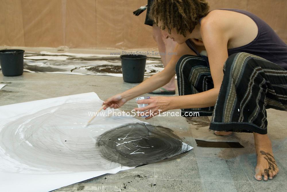Artist at work in her studio. Model released