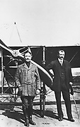 Louis Bleriot (1872-1936), right, French aviator and first man to cross English Channel in an airplane, July 1909. With him is the French air ace Adolphe Pegoud who was killed during World War I.
