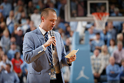CHAPEL HILL, NC - JANUARY 20: Jones Angell, radio announcer for the North Carolina Tar Heels, speaks as former player Justin Jackson of the Tar Heels is recognized at half time for having his jersey honored in the rafters of the Dean Smith Center during a game against the Georgia Tech Yellow Jackets on January 20, 2018 at the Smith Center in Chapel Hill, North Carolina. North Carolina won 80-66. (Photo by Peyton Williams/UNC/Getty Images) *** Local Caption *** Jones Angell