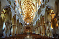 """Interior of the the medieval Wells Cathedral built in the Early English Gothic style in 1175, Wells Somerset, England . Its Gothic architecture is mostly in Early English style of the late 12th – early 13th centuries. Building began about 1175 at the east end with the choir. Historian John Harvey sees it as Europe's first truly Gothic structure. Its Early English front with 300 sculpted figures, is seen as a """"supreme triumph of the combined plastic arts in England"""".<br /> <br /> Visit our MEDIEVAL PHOTO COLLECTIONS for more   photos  to download or buy as prints https://funkystock.photoshelter.com/gallery-collection/Medieval-Middle-Ages-Historic-Places-Arcaeological-Sites-Pictures-Images-of/C0000B5ZA54_WD0s"""