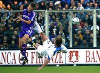 FIRENZE, 07/11/2004<br /> <br /> CAMPIONATO DI CALCIO SERIE A 2004/2005<br /> <br /> INCONTRO FIORENTINA-INTER<br /> <br /> Martin JORGENSEN Fiorentina (L) and Andy VAN DER MEYDE Inter<br /> <br /> FOTO GRAFFITI