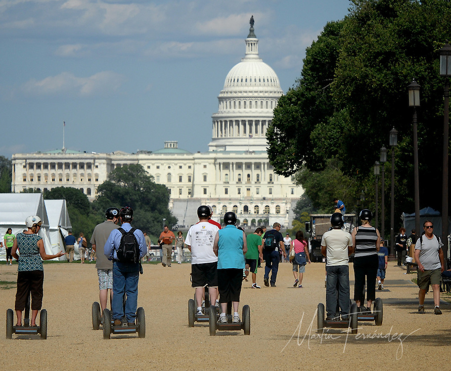 Toursists on segways head toward The Capitol building during a recent visit to Washington D.C.'s National Mall.