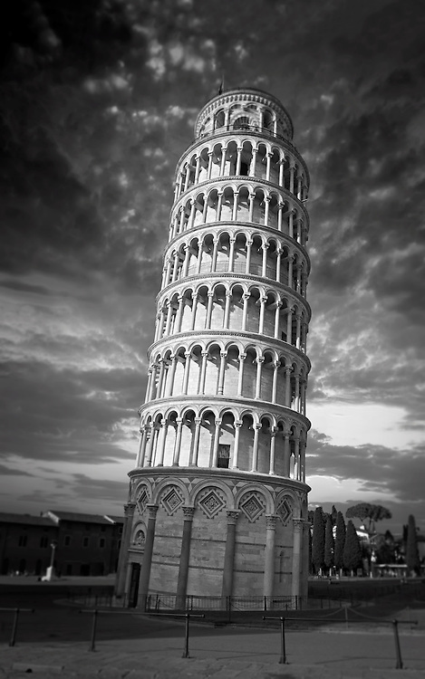 The Leaning Tower Of Pisa, Italy .  The Leaning Tower of Pisa (torre pendente di Pisa) or simply the Tower of Pisa  is the campanile, or freestanding bell tower, of the cathedral of the Italian city of Pisa, known worldwide for its nearly four-degree lean, the result of an unstable foundation. The Leaning Tower of Pisa is situated behind the Pisa Cathedral and is the third-oldest structure in the city's Cathedral Square (Piazza del Duomo). The height of the Leaning Tower of Pisa is 55.86 metres (183.27 feet) from the ground on the low side and 56.67 metres (185.93 feet) on the high side. The width of the walls at the base is 2.44 m (8 ft 0.06 in). The Leaning Tower of Pisa has 296 or 294 steps; the seventh floor has two fewer steps on the north-facing staircase. The Leaning Tower of Pisa began to lean during construction in the 12th century, due to soft ground which could not properly support the structure's weight, and it worsened through the completion of construction in the 14th century. By 1990, the tilt of the tower had reached 5.5 degrees .<br /> <br /> Visit our ITALY HISTORIC PLACES PHOTO COLLECTION for more   photos of Italy to download or buy as prints https://funkystock.photoshelter.com/gallery-collection/2b-Pictures-Images-of-Italy-Photos-of-Italian-Historic-Landmark-Sites/C0000qxA2zGFjd_k<br /> .<br /> <br /> Visit our MEDIEVAL PHOTO COLLECTIONS for more   photos  to download or buy as prints https://funkystock.photoshelter.com/gallery-collection/Medieval-Middle-Ages-Historic-Places-Arcaeological-Sites-Pictures-Images-of/C0000B5ZA54_WD0s