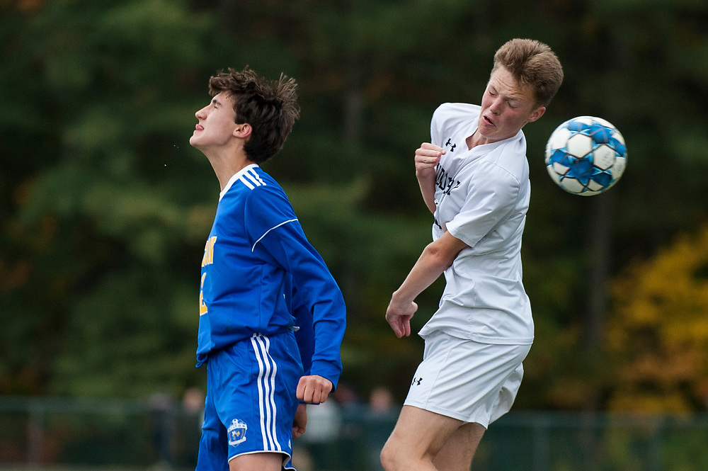 Middlebury's Hunter Munteanu (12) and Milton's Manolis Anemikos (21) battle to head the ball during the high school boys soccer game between the Middlebury Tigers and the Milton Yellowjackets at Milton High School on Wednesday afternoon October 16, 2019 in Milton, Vermont. (BRIAN JENKINS/for the FREE PRESS)