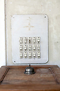 A detail of a bell and switches in The Villa Helena, an upscale Heritage Hotel, Pondicherry, India<br /> Pondicherry now Puducherry is a Union Territory of India and was a French territory until 1954 legally on 16 August 1962. The French Quarter of the town retains a strong French influence in terms of architecture and culture.