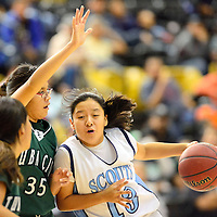 1212713  Adron Gardner/Independent<br /> <br /> Window Rock Scout Danielle Smiley (13), right, drives past the Tuba City Warriors in Chinle Friday.