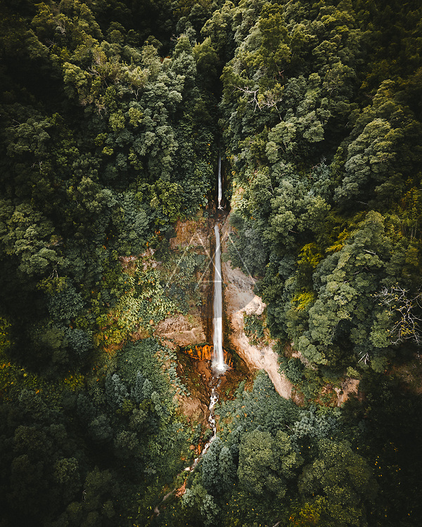Aerial view of Ribeira Quente waterfall in the forest on Sao Miguel island, Azores archipelagos, Portugal.