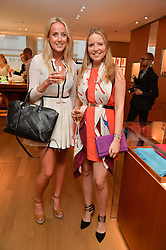 Left to right, JEMIMA CADBURY and ARABELLA HOLLAND at a party to celebrate the launch of Le Jardin de Monsieur Li by Hermes in association with Mr Fogg's was held at Hermes, 155 New Bond Street, London on 9th July 2015.