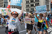 LGBT supporters of President Obama carry signs in support of his 2012 re-election.