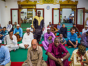 01 SEPTEMBER 2017 - BANGKOK, THAILAND: Men pray at Haroon Mosque during the celebration of Eid al-Adha. Eid al-Adha is also called the Feast of Sacrifice, the Greater Eid or Baqar-Eid. It honours the willingness of Abraham to sacrifice his son. Goats, sheep and cows are sacrificed in a ritualistic manner after services in the mosque. The meat from the sacrificed animal is supposed to be divided into three parts. The family retains one third of the share; another third is given to relatives, friends and neighbors; and the remaining third is given to the poor and needy.     PHOTO BY JACK KURTZ
