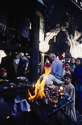 Kathmandu, 13 February 2005. Fire burning at  Swayambhunath Temple