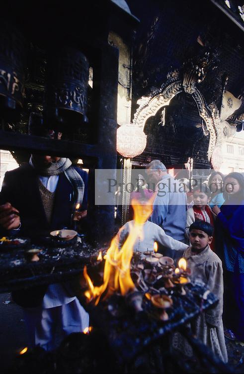 Kathmandu, 13 February 2005. Fire burning at  Swayambhunath Temple