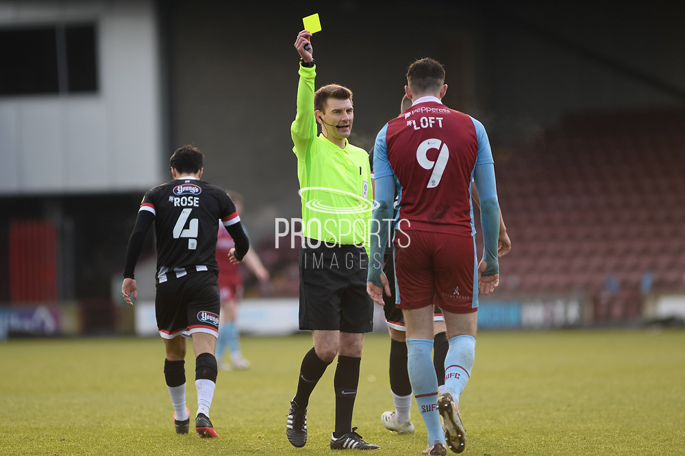 Scunthorpe United Ryan Loft (9) is shown a yellow card, booked by Referee Ollie Yates during the EFL Sky Bet League 2 match between Scunthorpe United and Grimsby Town FC at the Sands Venue Stadium, Scunthorpe, England on 23 January 2021.