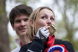 © licensed to London News Pictures. London, UK 08/05/2012. Claire Lomas, who paralysed from the chest down after an accident, finishes  the London Marathon and kissing her medal today after 16 days with a robotic suit to raise money for Spinal Research (08/05/12). Photo credit: Tolga Akmen/LNP