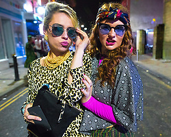 © Licensed to London News Pictures . 27/12/2017. Wigan, UK. Patsy and Edina from Absolutely Fabulous. Revellers in Wigan enjoy Boxing Day drinks and clubbing in Wigan Wallgate . In recent years a tradition has been established in which people go out wearing fancy-dress costumes on Boxing Day night . Photo credit: Joel Goodman/LNP