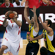 Fenerbahce Ulker's Omer ONAN (C) and Olimpiakos's Pero ANTIC (L) during their Two Nations Cup basketball match Fenerbahce Ulker between Olimpiakos at Abdi Ipekci Arena in Istanbul Turkey on Saturday 01 October 2011. Photo by TURKPIX