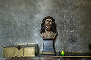 A bust of Jesus Christ in the San Nicolas Tolentino Temple and Ex-Monastery in Actopan, Hidalgo, Mexico. The colonial church and convent  was built in 1546 and combine architectural elements from the romantic, gothic and renaissance periods.