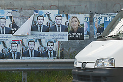 June 10, 2017 - Caen, France - Old posters dating May 2017 French presidential election of newly elected French President Emmanuel Macron, seen in Caen on the eve of French legislative elections...French legislative elections are scheduled to take place on 11 and 18 June (with different dates for voters overseas) to elect the 577 members of the 15th National Assembly of the French Fifth Republic. According to the final list published by the Ministry of the Interior on 23 May, a total of 7,882 candidates are standing in the legislative elections..On Saturday, June 10, 2017, in Caen, Calvados, France. (Credit Image: © Artur Widak/NurPhoto via ZUMA Press)