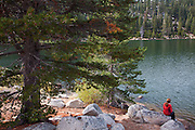 A hiker stops a Marlette Lake on the Flume Trail, Lake Tahoe, NV (model released)