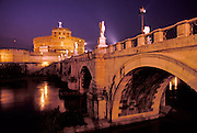 The Castel Sant'Angelo, is a cylindrical building in Rome commissioned by the Roman Emperor Hadrian as a mausoleum for himself and his family.  Built in 139 AD, the building has been used as a fortress and a castle, and is now a museum.  On the right is the Ponte Sant'Angelo (bridge).