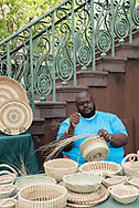 Corey Alston making sweetgrass baskets at the Charleston City Market. Alston is a 5th generation basket maker (we have his direct contact information).