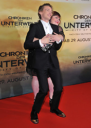 Jamie Campbell Bower and Cassandra Clare arrives for the 'The Mortal Instruments: City of Bones' Germany premiere at Sony Centre on Tuesday August 20, 2013 in Berlin, Germany. Photo by Schneider-Press / John Farr / i-Images. <br /> UK & USA ONLY