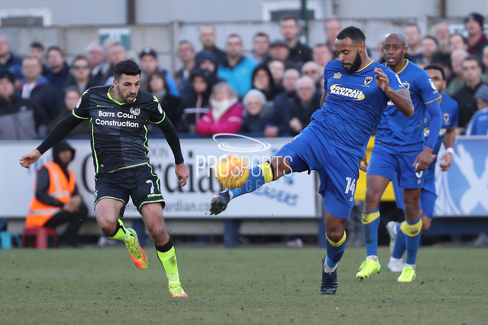 AFC Wimbledon midfielder Liam Trotter (14) clearing the ball during the EFL Sky Bet League 1 match between AFC Wimbledon and Bristol Rovers at the Cherry Red Records Stadium, Kingston, England on 17 February 2018. Picture by Matthew Redman.