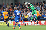 AFC Wimbledon goalkeeper George Long (1) saves from Oldham Athletic forward Craig Davies (9) during the EFL Sky Bet League 1 match between AFC Wimbledon and Oldham Athletic at the Cherry Red Records Stadium, Kingston, England on 21 April 2018. Picture by Matthew Redman.