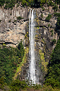 """Nachi-no-Taki waterfall (133 m, Japan's tallest), in Nachikatsuura, on the Kii Peninsula, on the island of Honshu, Japan. Don't miss the iconic view of thundering Nachi-no-Taki waterfall (133 m, Japan's tallest) paired with Seiganto-ji pagoda. According to a legend, it was founded (near a previous nature worship site) by the priest Ragyo Shonin, a monk from India. Seiganto-ji is part of the Kumano Sanzan shrine complex and is one of the few jingu-ji still in existence after the separation of Shinto and Buddhism forced by the Japanese government during the Meiji restoration. Seiganto-ji is is stop #1 on Kansai Kannon Pilgrimage, and is part of a UNESCO World Heritage Site listed as the """"Sacred Sites and Pilgrimage Routes in the Kii Mountain Range"""". Access: by bus from Nachi Station (20 min) or Kii-Katsuura Station (30 min). Ask driver to stop at base of the Daimonzaka trail (""""Daimonzaka"""" stop); or at the entrance to Nachi Waterfall (""""Taki-mae""""); or at the bus terminus 10 minutes climb below Nachi Shrine (""""Nachi-san""""). Cars can park at Seigantoji Temple. I recommend this scenic, short walk (3.5 km with 265 meters gain): starting from Daimon-zaka bus stop, ascend a stone-paved path, humbled by massive evergreens, up to the gates of Nachi Taisha shrine, descend to Seiganto-ji pagoda, then to the falls, just below Taki-mae bus stop."""