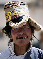 Aged man seen in Ladakh, India wearing a traditional hat. Photographed by Jayne Fincher