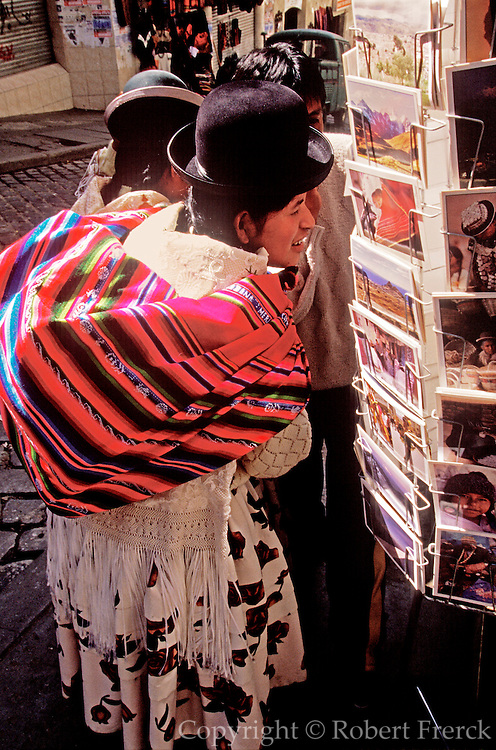 BOLIVIA, LA PAZ the country's largest city, Ave. Sagamaga  in the old colonial area; Indian woman buying postcard in Mercado de Hechiceria
