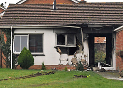 © Licensed to London News Pictures. 20.01.2012. Wool, Dorset. Damage can be seen at the bungalow. A 51-year-old man has been arrested on suspicion of attempted murder after a fuel tanker has smashed into a bungalow in Dorset and set it ablaze. Around 30 firefighters were called to the blaze, which swept through the house after the tanker smashed through the front windows. Photo credit: Christopher Gretkus/LNP