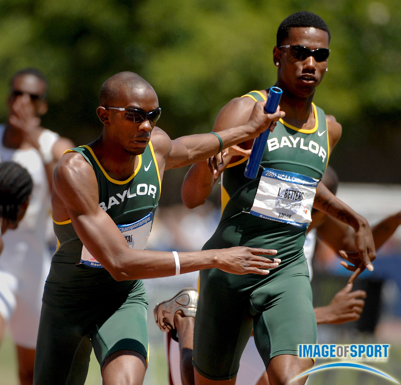 Kevin Mutai of Baylor takes handoff from LeJerald Betters on the anchor of victorious 4 x 400-meter relay that timed 3:00.04 in the NCAA Track & Field Championships at Sacramento State's Hornet Stadium in Sacramento, Calif. on Saturday, June 9, 2007.