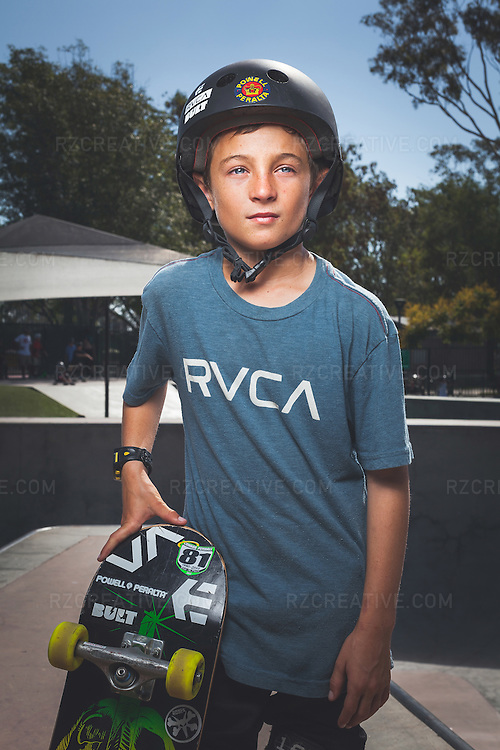 Portrait of 10-year old skateboarder Taylor Nye photographed at the Costa Mesa, Calif. skatepark on August 18, 2014. Photo by Robert Zaleski/rzcreative.com