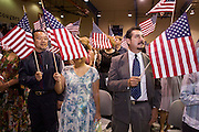 July 4, 2008 -- Phoenix, AZ: New US citizens take the oath of citizenship at a naturalization ceremony in Phoenix, AZ, Friday. About 300 people from 41 countries were naturalized as US citizens at South Mountain Community College, in Phoenix, AZ, Friday. It was the 20th year the college has hosted the Fiesta of Independence. More than 5,000 people have become naturalized US citizens at the Fiesta of Independence. More than 5,000 people have become naturalized US citizens at the Fiesta of Independence. The largest number of new citizens, 158, came from Mexico. There were also large numbers of new citizens from the Philippines, Bosnia-Herzegovnia and India.  Photo by Jack Kurtz