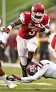 Texas A&M defensive back De'Vante Harris (1) attempts a tackle on Arkansas Razorbacks running back Alex Collins (3) as offensive tackle David Hurd defends during an NCAA college football game in Fayetteville, Ark., Saturday, Sept. 28, 2013. Texas A&M defeated Arkansas 45-33. (AP Photo/Beth Hall)