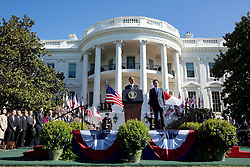 President Barack Obama delivers remarks during the State Arrival ceremony for Prime Minister Shinzo Abe of Japan on the South Lawn of the White House, April 28, 2015.(Official White House Photo by Pete Souza)<br /> <br /> This official White House photograph is being made available only for publication by news organizations and/or for personal use printing by the subject(s) of the photograph. The photograph may not be manipulated in any way and may not be used in commercial or political materials, advertisements, emails, products, promotions that in any way suggests approval or endorsement of the President, the First Family, or the White House.