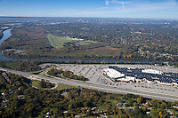 Aerial photo of Cornelia Fort Airpark in Nashville Tennessee showing the Downtown skyline, Briely Parkway and Opry Mills Mall.