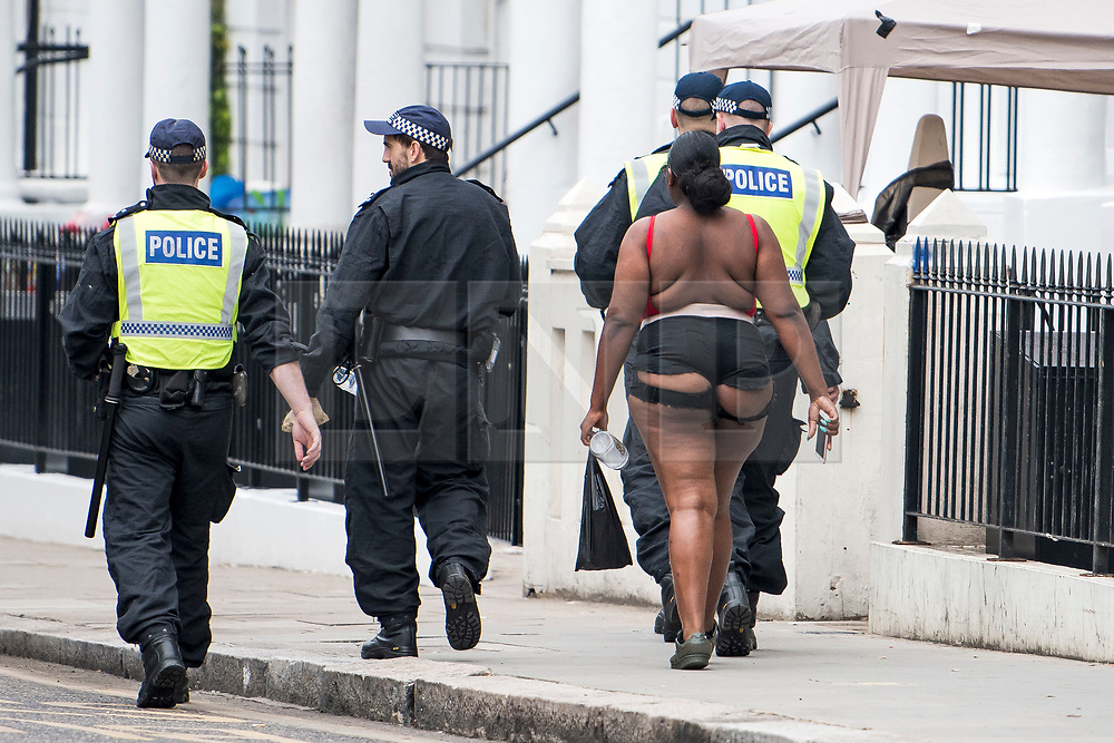 © Licensed to London News Pictures. 26/08/2018. London, UK. A heavy police presence at family day of the 2018 Notting Hill Carnival. Up to 1 million people are expected to attend this weekend's event that is one of the worlds largest street festivals. Photo credit: Ben Cawthra/LNP