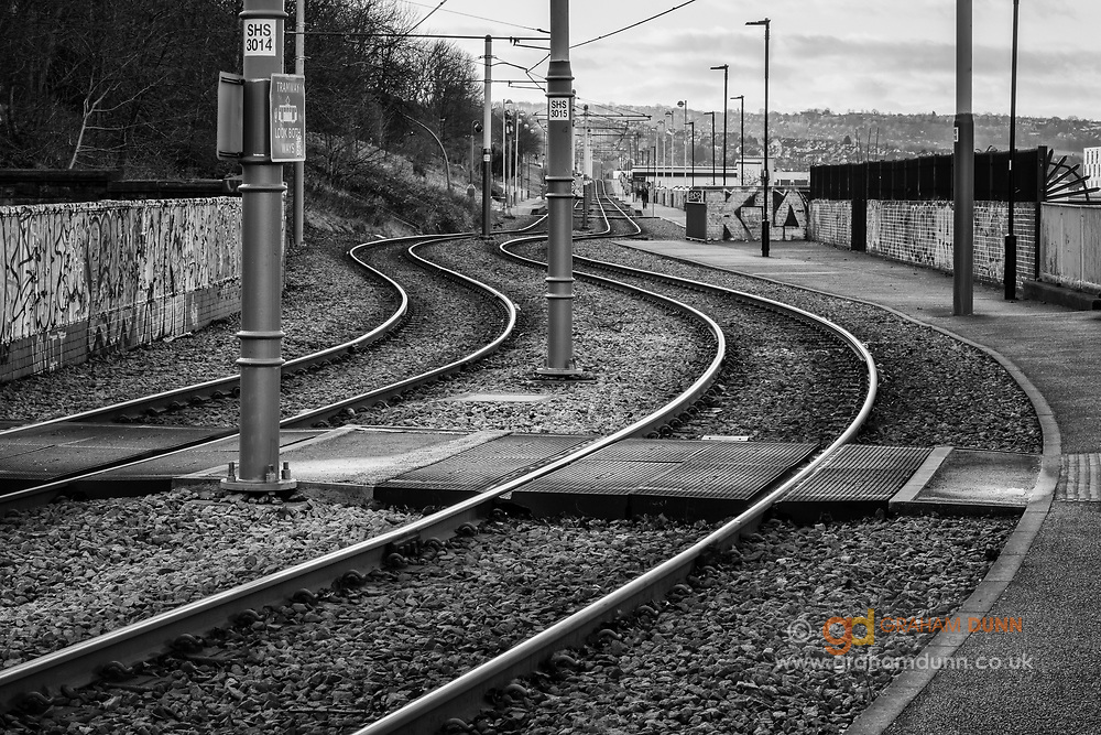 Morning light reflects off these curving tram tracks and emphasises their wonderful shape. An urban landscape scene near to Sheaf Street and the Parkhill Flats in Sheffield, South yorkshire, UK.