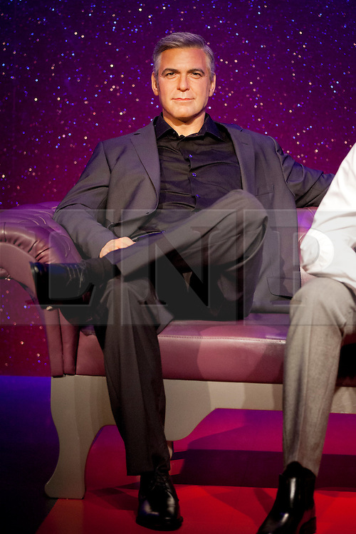 © Licensed to London News Pictures. 22/05/2013. London, UK. A waxwork figure of American actor, film director, producer, and screenwriter George Clooney is seen in the 'A-List Party' exhibition inside Madame Tussauds in London today (22/05/2013). Photo credit: Matt Cetti-Roberts/LNP